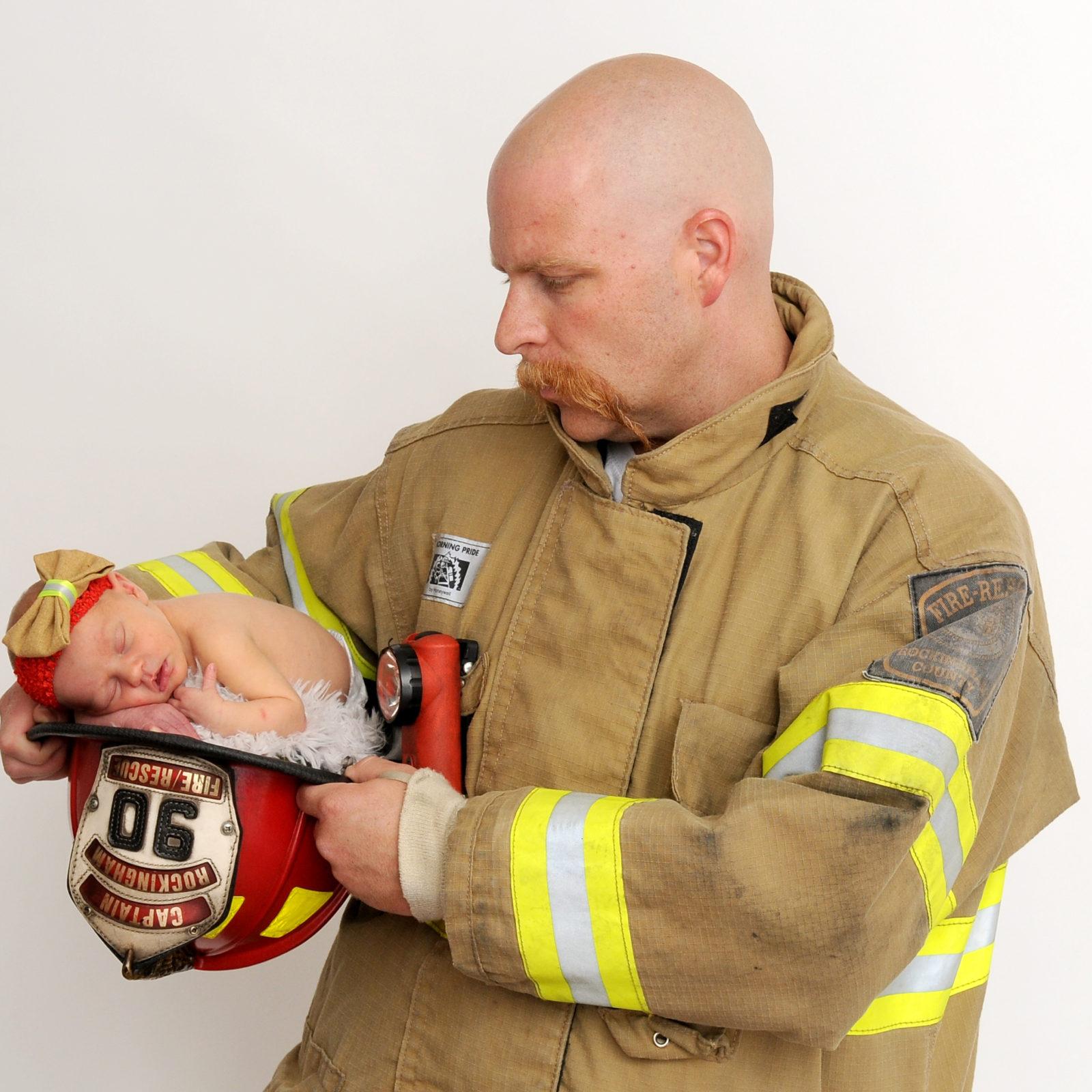 Firefighter with newborn portrait photography Harrisonburg